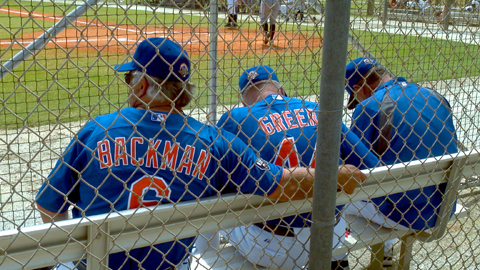 Manager Wally Backman and the Bisons coaching staff watch Sunday's action.